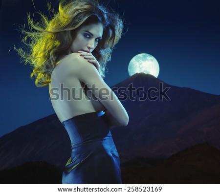 Seductive lady at moonlight - stock photo