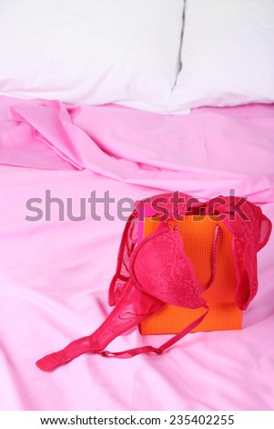 Seductive lingerie in present box on bed close-up - stock photo