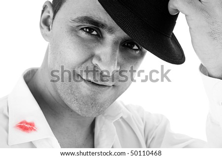 seductive man greeting with his hat and shirt with lipstick mark - stock photo