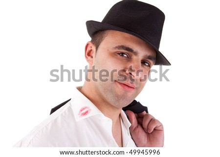 seductive man with his hat, the shirt with lipstick mark - stock photo