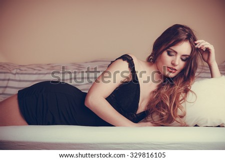 Seductive sexy gorgeous woman wearing lingerie in bed at home. Attractive sensual young girl. Female underwear fashion. - stock photo