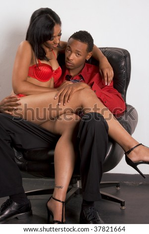 Seductive woman of Creole ethnicity working with client, ethnic African-American businessman - stock photo
