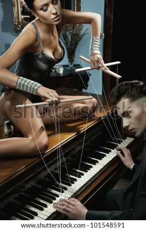 Seductive woman on the piano - stock photo