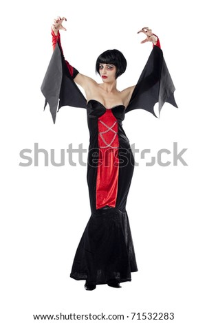 Seductive young female model dressed as vampire. Isolated on pure white background. - stock photo