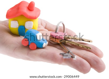 See my other key images. Homemade house and car with keys placed on hand with white background - stock photo