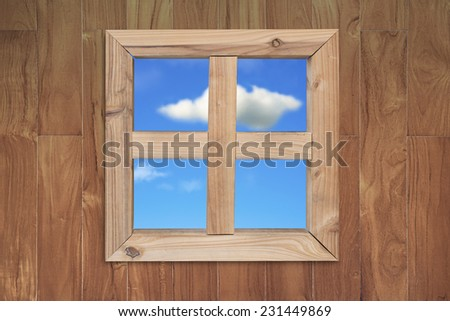see natural blue sky clouds through wooden window with teak textured wall background - stock photo