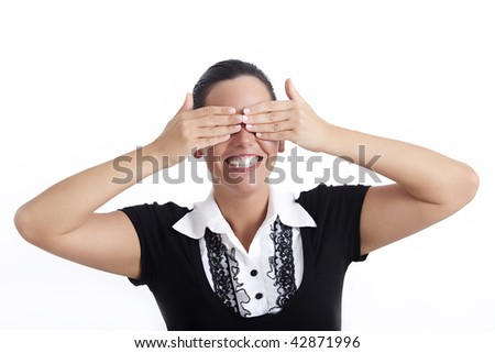 See no evil - young businesswoman covering her eyes with hands - stock photo