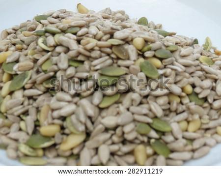Seed mixture of Pumpkin, sunflower and sesame seeds - stock photo