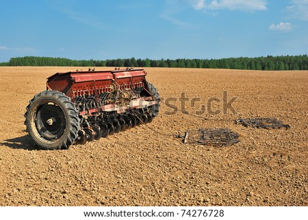 Seeder - Agricultural machinery. Field work. - stock photo