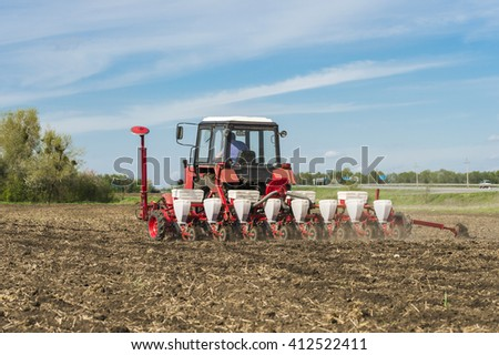 seeders agricultural tractor - stock photo