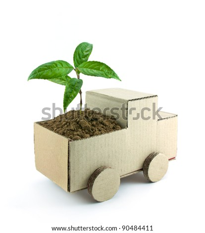 seedling in car isolated on white background, conservation concept - stock photo