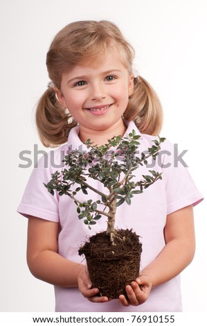 Seedling - little girl and young tree - stock photo
