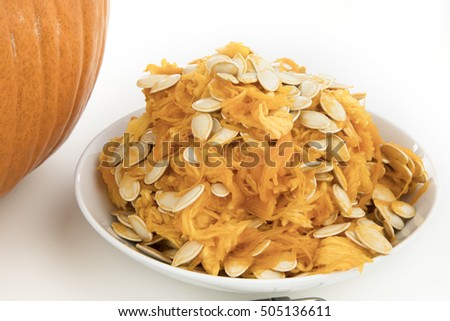 Seeds and pumpkin scrapings from preparing pumpkin for carving