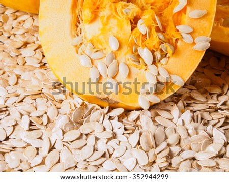 Seeds are falling out from a ripe cut pumpkin  - stock photo