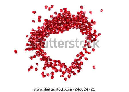 Seeds of grenadine in shape of heart, concept - stock photo