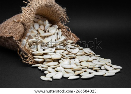 seeds of pumpkin in a sack - stock photo