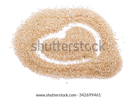 Seeds of uncooked quinoa, heart sign on white, source of protein for vegetarians - stock photo