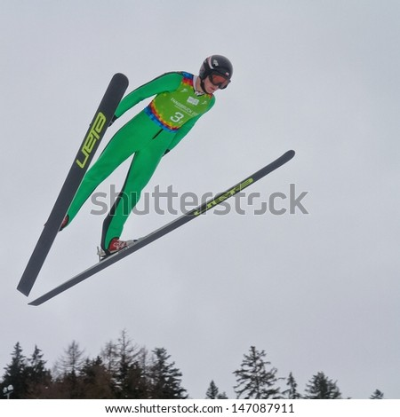 SEEFELD, AUSTRIA - JANUARY 19 Michal Pytel (Poland) jumps in Seefeld during a training session on January 19, 2012 in Seefeld, Austria. - stock photo
