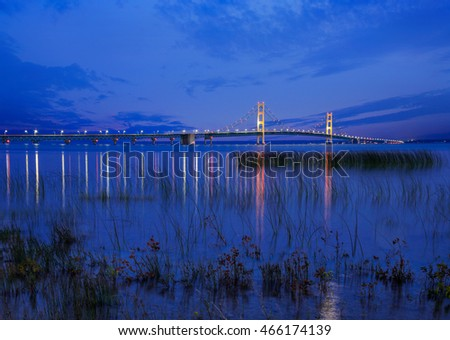 Seen From St Ignace in the upper peninsula at dusk, the Mackinac Bridge spans the upper and lower peninsulas of Michigan, USA