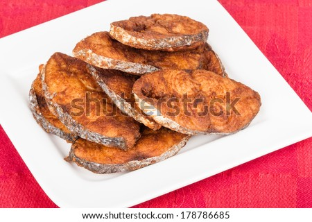 Seer Fish Fillets Fry - Delicious seer/mackerel fish fillets fry. The fish is marinated in cayenne pepper, salt and deep fried. - stock photo