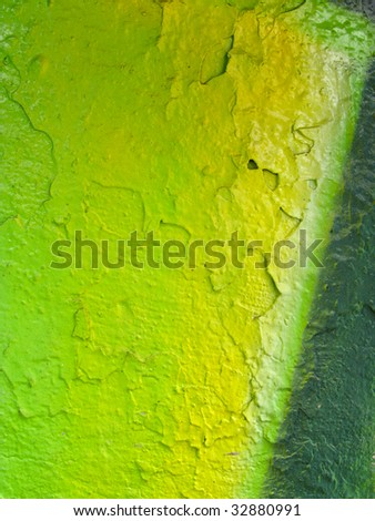 segment of a brightly painted wall in shades of green - stock photo