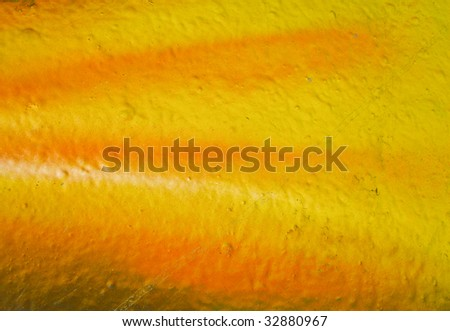 segment of a brightly painted wall in shades of orange - stock photo