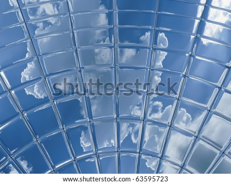 segment of a metal disk which reflects a bright cloudy sky - stock photo