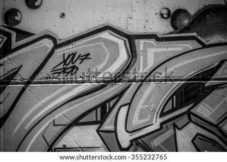 segment of a street art grafitti in black and white ink - stock photo