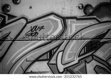 segment of a street art grafitti in black and white ink - stock photo
