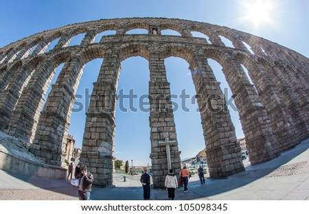 SEGOVIA - MAR 30: The Roman Aqueduct of Segovia on March 30, 2012 in Segovia, Spain. The famous monument has been chosen by Google to join the new World Wonders Project - stock photo