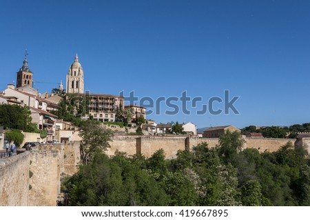 SEGOVIA - MAY 16, 2015: Views of the city of Segovia, with the Cathedral and the Church of Saint Andrew in the background, in Segovia, Spain on May 16, 2015. - stock photo