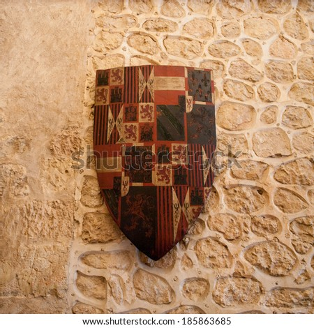 SEGOVIA, SPAIN - APR 5, 2014: Shield inside the Alcazar of Segovia (Segovia Castle), a stone fortification, Segovia, Spain. It's one of the inspirations for Walt Disney's Cinderella Castle. - stock photo