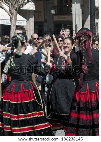 SEGOVIA  SPAIN - MARCH 16 2014 - Spanish folk dancers with sticks in the ancient Roman city of Segovia, Spain .