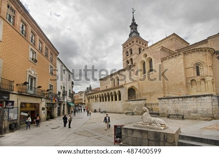 Segovia, Spain - May 30, 2016: People walk near the San Martin church in the town of Segovia, Spain on May 30, 2016