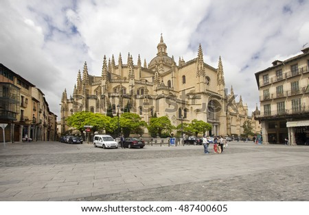 Segovia, Spain - May 30, 2016: People walking on the town square next to the cathedral in Segovia, Spain on May 30, 2016