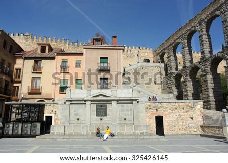 SEGOVIA, SPAIN - OCTOBER 23, 2014: A photograph of ancient Roman aqueduct on Plaza del Azoguejo in a historic city of Segovia, Spain, Oct.23, 2014. - stock photo