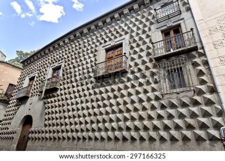 SEGOVIA, SPAIN - SEPTEMBER 14, 2014: Casa de los Picos with its facade covered by granite blocks carved into diamond-shapes in Segovia, Spain. - stock photo