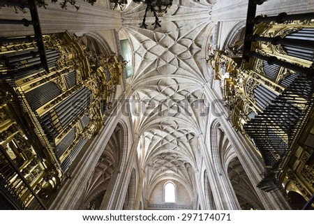 SEGOVIA, SPAIN - SEPTEMBER 14, 2014: View of the ceiling and the pipe organs of the Cathedral of Segovia, Spain. - stock photo