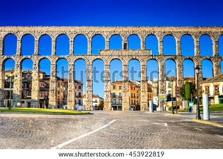 Segovia, Spain. Town view at Plaza del Artilleria and the ancient Roman aqueduct, Castilla y Leon - stock photo