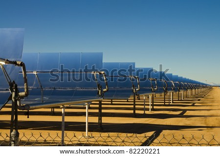 SEGS solar thermal energy electricity plant with parabolic mirrors concentrating the sunlight