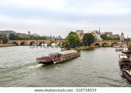 Seine and Notre Dame de Paris cathedral in Paris, France in a summer day - stock photo