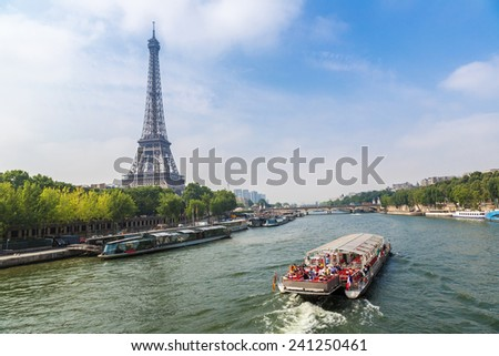 Seine in Paris and Eiffel tower in beautiful summer day - stock photo