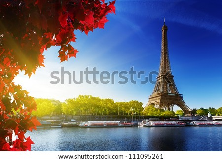 Seine in Paris with Eiffel tower in autumn time - stock photo