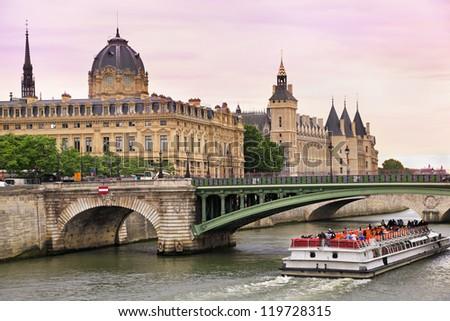 Seine River and Bateau Mouche in Paris, France - stock photo