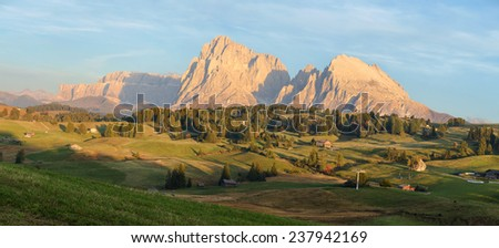 Seiser Alm (Alpe di Siusi) with Plattkofel and Langkofel mountains at sunset , Southern Tyrol, Italy - stock photo