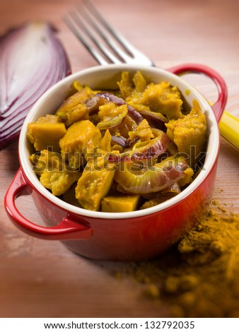 seitan stew with curry and onions, selective focus - stock photo