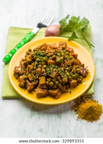 seitan stew with peas and curry, vegetarian food, selective focus - stock photo