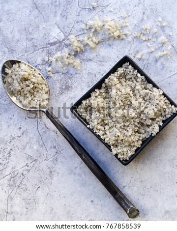 Sel Marin de Guerrande Sea Salt in a Black Bowl With a Spoon