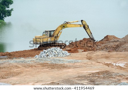 SELANGOR, MALAYSIA -APRIL 25, 2016: Excavators machine is heavy construction machine used excavate soil at the construction. Powered by long hydraulic arm with bucket. Handle by workers.