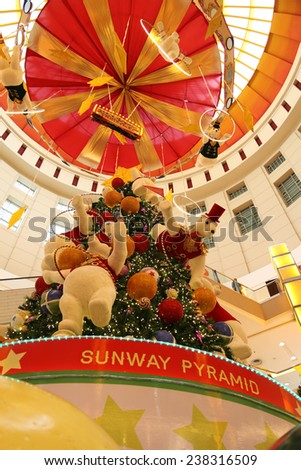 "SELANGOR, MALAYSIA - DECEMBER 17: The beautiful Christmas decorations at Sunway Pyramid Shopping Mall on December 17, 2014 in Selangor, Malaysia. Theme of this year is ""A Hoopful Christmas"". - stock photo"